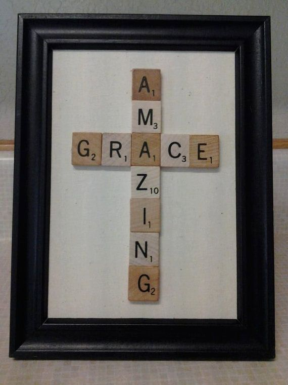 Framed Amazing Grace Cross made with scrabble tiles maybe with an American flag background and a plain black frame