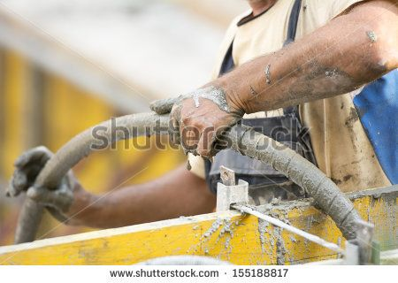 Close up photo of hard working man on construction site  - stock photo