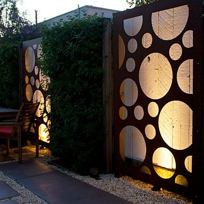 Decorative metal panels, placed in front of a back lit plain fenceGardens Fence, Metals Panels, Vegetables Gardens, Yards Privacy, Outdoor Gardens, Lights Ideas, Dreams Gardens, Shades Of Green, Backyards