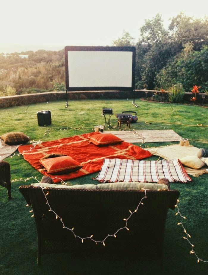 Brilliant! Backyard movie night! What a fun thing to do with friends and family on those warm summer nights :)