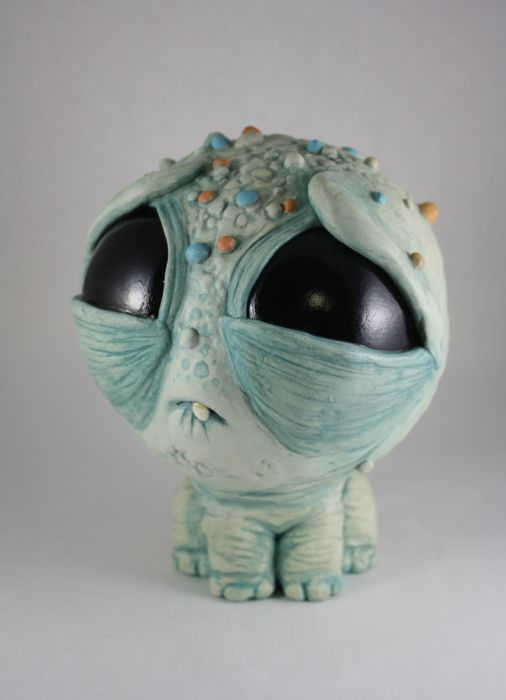 These melancholy, big-eyed monsters were created by Chris Ryniak. Click to see more.