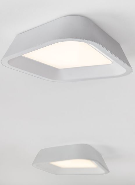 The modern asymmetric outer metal shade of the rhonan flush mount ceiling light from tech