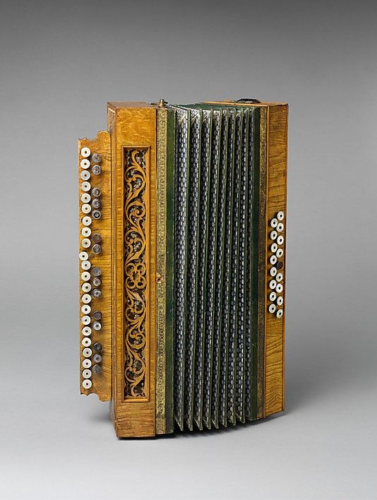 "1890 Belgian Accordion at the Metropolitan Museum of Art, New York - From the curators' comments: ""An early chromatic accordion with an arrangement of buttons like a piano keyboard and seventeen free basses."" http://www.pinterest.com/TheHitman14/music-instruments/"
