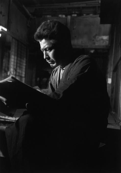 """Toshiro Mifune during the filming of the movie """"Hokaïdo"""", which changed its title to """"Bijo to Tozoku"""", Daisi studios, Tokyo, 1951 by Werner Bischof"""