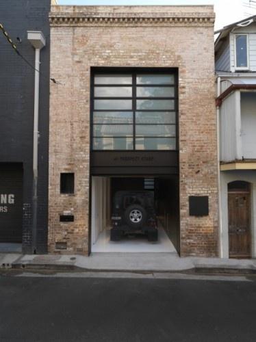 Garage Design:  Subtle modern detailing + classic brick facade = Timeless