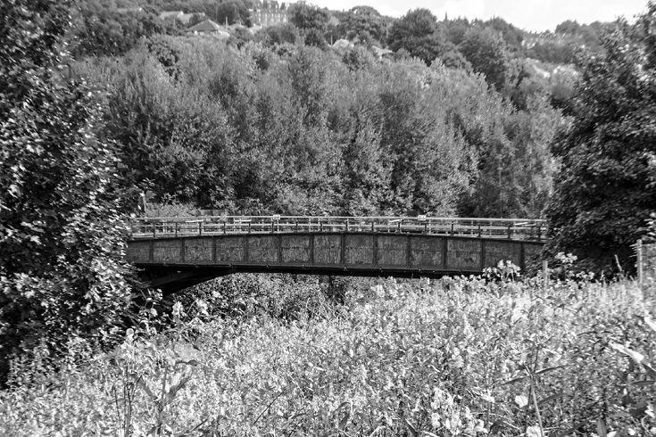 The Grade 2 listed Gas Works Bridge crossers the River Calder near to the town of Sowerby Bridge, West Yorkshire. It is currently only accessible by pedestrians having been closed in the 1980s. More of my pictures and information can be seen at, www.colingreenphotography.blogspot.co.uk
