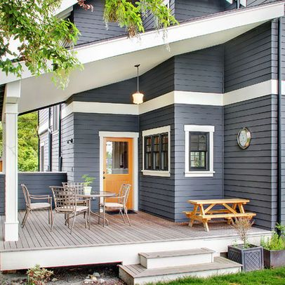 Dark Blue/Gray Exterior with dark windows, white trim, and orange door