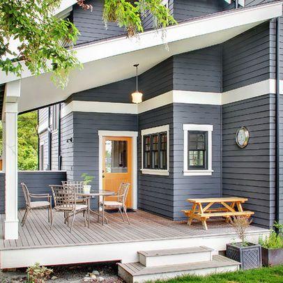 Dark Blue/Gray Exterior with dark windows, white trim, and orange door