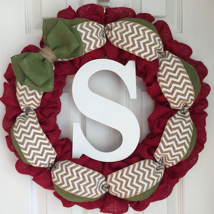 """Red Burlap Wreath for Front Door - Monogram Holiday Wreath - Holiday Burlap Wreath - Red and Green Door Hanger - Holiday Door Hanger. Burlap monogram holiday wreath made on a 16"""" wire frame. The finished product is about 20"""" in diameter. Each wreath is handmade and may differ slightly from the example shown in the photo. I make every effort to ensure each wreath is full and even. All my wreaths are made to order so please allow 1-2 weeks of processing time. Thank you for your interest in..."""