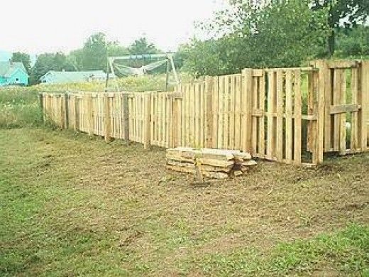 How to build cheap fence out of pallets out of the woods for Pretty fencing ideas