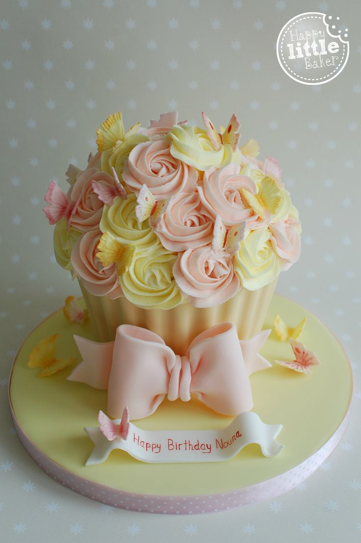Birthday Giant Cupcake Cake. Lemon and peach butterfly themed giant cupcake.
