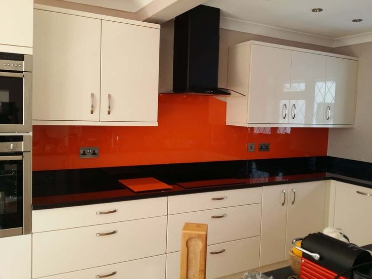 Pure Orange kitchen glass splashback by CreoGlass Design (London, UK). Visit our website for more coloured glass kitchen splashbacks www.creoglass.co.uk #orangekitchen #modernkitchen