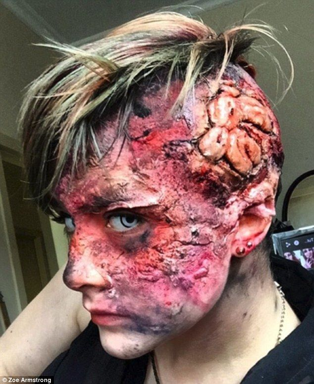 Halloween dream: Zoe Armstrong, a special effects make-up artist fromDunedin, New Zealand, used latex, cotton, and wax to create this charred skull look with exposed brain on a homemade latex bald cap