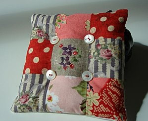 The button tufting really adds interest to this simple pincushion.