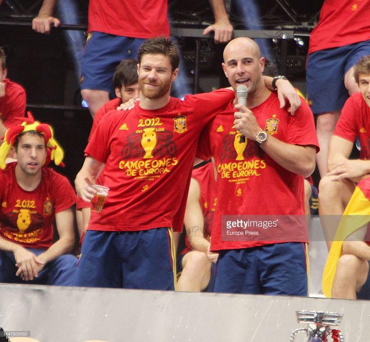 Xabi Alonso (L) and Pepe Reina (R) attend UEFA EURO 2012 Champions Spain Victory Parade and celebrations on July 2, 2012 in Madrid, Spain.