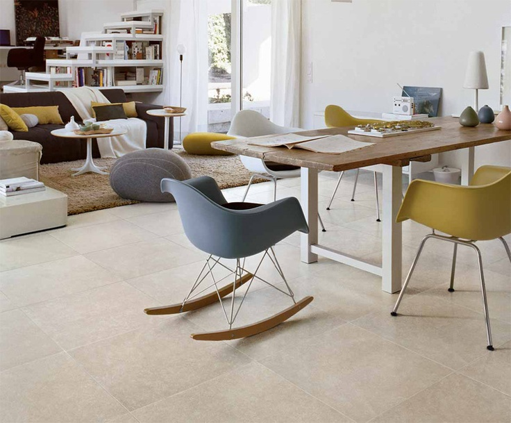Available in four warm colours, Pietra Mediterranea creates refined, enveloping atmospheres in which domestic warmth is accompanied by the appeal of nature.  With its deep, warm shades crossed by brownish streaks, Pietra Mediterranea (Mediterrean Stone) has a welcoming, rustic charm. The colore in the living room is Bianco (white).