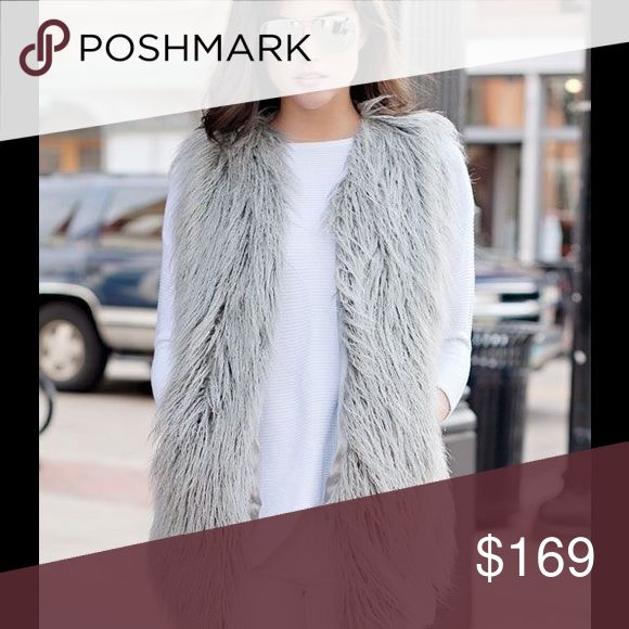 Vest Beautiful Tibetan lamb faux fur vest. Can dress up for a night out or dress down with a pair of jeans. Comes in blue or gray Jackets & Coats Vests