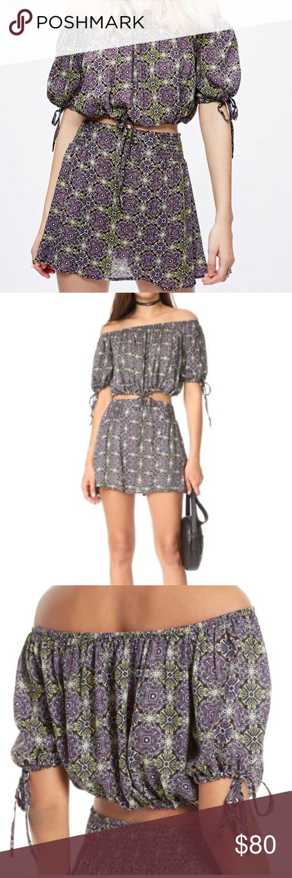 Free People Electric Love Two Piece Set This soft printed set features an off-the-shoulder crop top with an elastic band at the waist and bust. Relaxed sleeves with tie closures. Flowy skirt has a smocked waistband.  100% Rayon Machine Wash Cold Free People Dresses Mini
