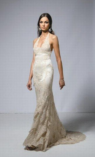 A lacy wedding dress built for hourglass figures. I love the halter top. $??? Unfortunately, I don't know where to purchase the dress.