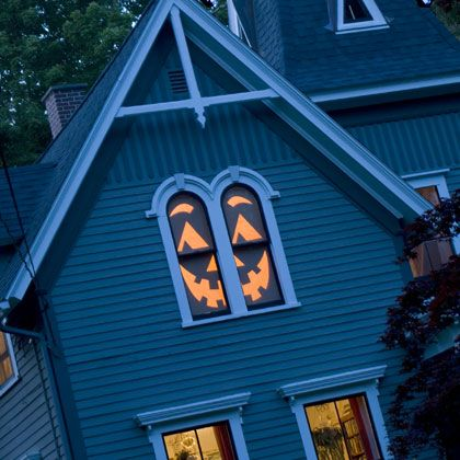 Jack-o'-Lantern Haunted House Halloween Decoration --- totally doing this for the big picture window next to the front porch!