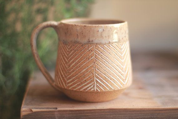 Handcrafted mug inspired in part by mid-century Scandinavian design as well as a modern rustic aesthetic. Glazed in natural cream over speckled clay with a hand etched herringbone design. This mug holds 16-18oz of your favorite beverage.  Each piece is thrown by hand at my home studio on the Central Coast of California. *microwave and dishwasher safe. *non-toxic lead free and food safe glaze.