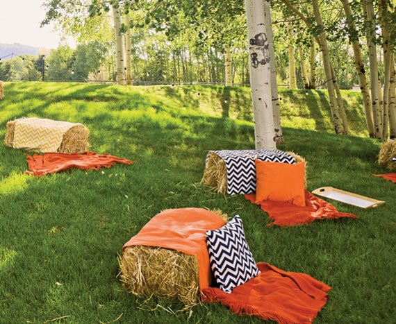 Guests sat on haystacks covered with bright orange blankets and chevron-patterned pillows at a Belvedere-sponsored party during the 2012 Food & Wine Classic in Aspen, Colorado. Though the pictured seating configuration is more suited to causal dining, haystacks in rows or in the round could make for fun  conference seating during the warmer months.