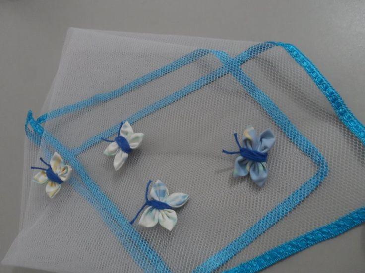Cobre alimento em tule, decorado com fuxico de borboletas azul.    Temos diversos tamanhos e preços.    Escolha sua cor, modelo e tamanho e passo seu orçamento.    Também temos tamanho para cobrir toda a mesa!