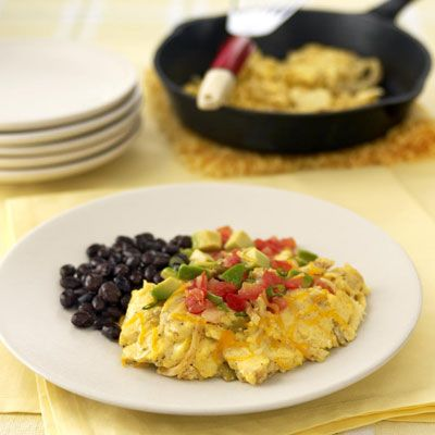 Corn tortilla strips, green chiles and cheese turn ordinary scrambled eggs into this Southwestern Scramble. Top with salsa, avocado and green onions for a pretty presentation. Serve with beans if desired.