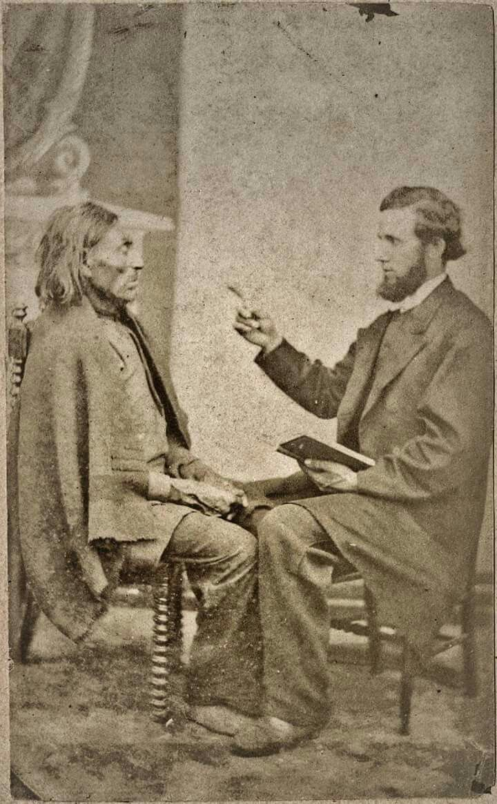 """Title  ~ """"Preaching to Indian from Bible"""", c1874. From: Carte-de-visite photographs of Northwest Indians. 9.2 x 5.8 cm. Victoria, British Columbia, Canada. Hannah Maynard, photographer."""