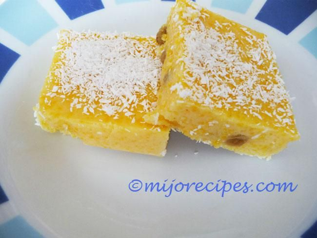 'Pudding Mais' - Maize Pudding is a popular and affordable local dessert, made with Maize  powder (the yellow variety), Milk, Sugar, raisins, and sprinkled with coconut powder.