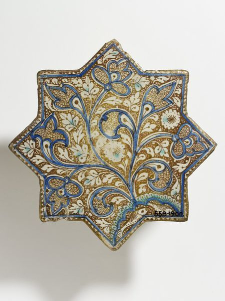 Tile      Place of origin:      Iran (made)     Date:      13th century-14th century (made)     Artist/Maker:      unknown (production)     Materials and Techniques:      Fritware, painted with lustre over the glaze     Museum number:      559-1900