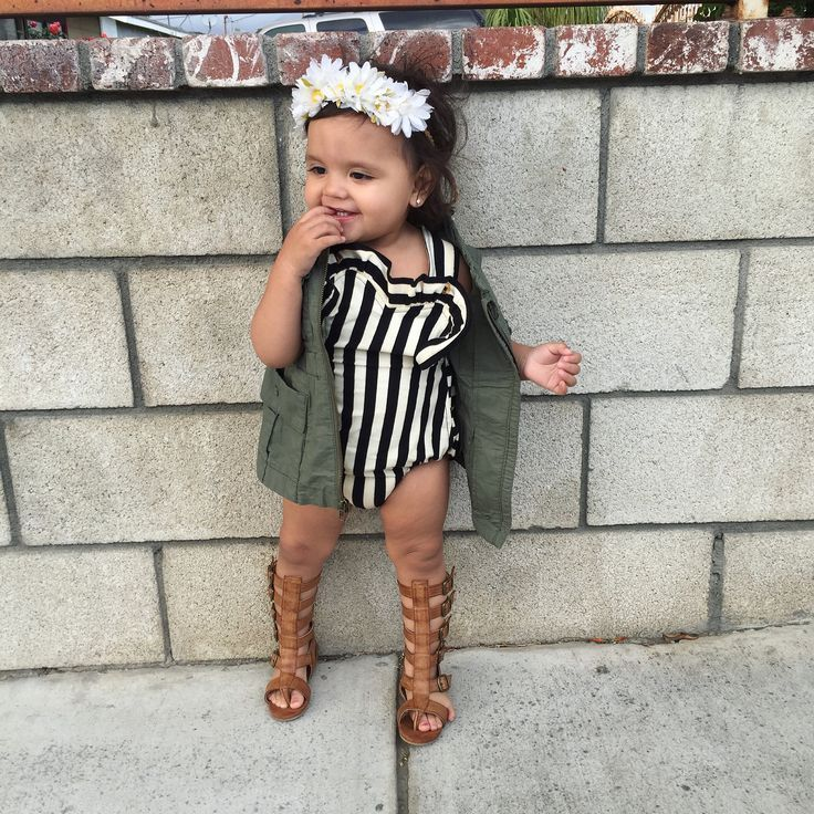 Baby girl/ toddler spring fashion outfits. Baby girl/ toddler summer fashion outfits. Joyfolie Gladiator sandals. Sadie Then Ty stripped romper. Old navy olive cargo vest. Forever 21 daisy headband. #toddlersandals #babygirlvest #toddlervest #babysandalsg https://presentbaby.com