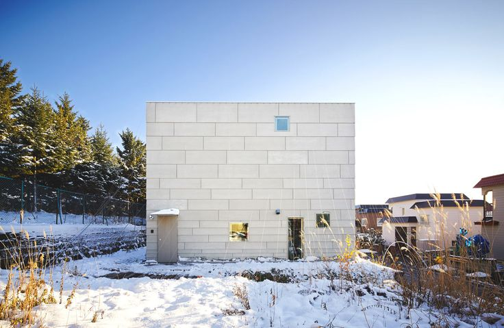 Located in Sapporo, Hokkaido, Japan, this house looks like a simple box design on the exterior, but the white and wood interior is full of surprises.