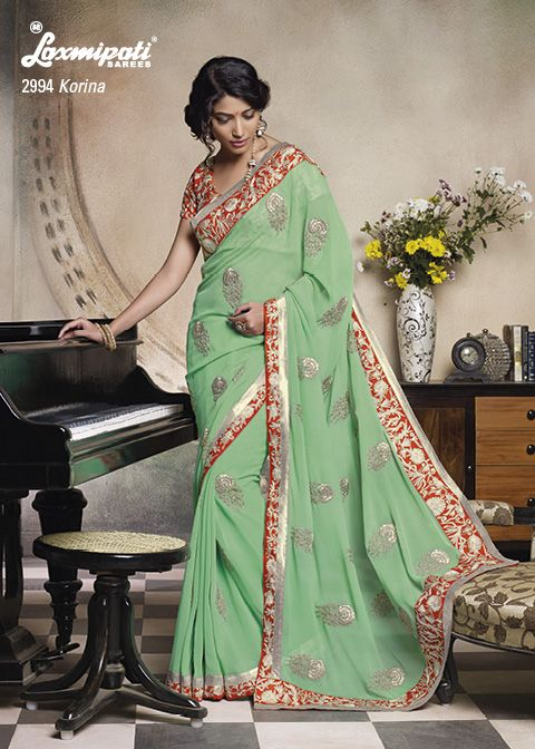 Pista colored georgette saree with fabulous border & zari- embroidery work along with heavy work on blouse ,Seriously incomparable.