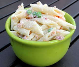 Bacon Ranch Pasta Salad  Printer Friendly Recipe    Ingredients  1 lb pasta  3/4 c. Ranch dressing  3/4 sour cream  1 c. frozen peas, thawed  1 c. shredded carrot  1/2 c. real bacon bits    1. Prepare pasta according to directions. Rinse with cold water and drain well.    2. In a large bowl combine other ingredients. Stir in pasta and combine well. Chill for 2 hours before serving.