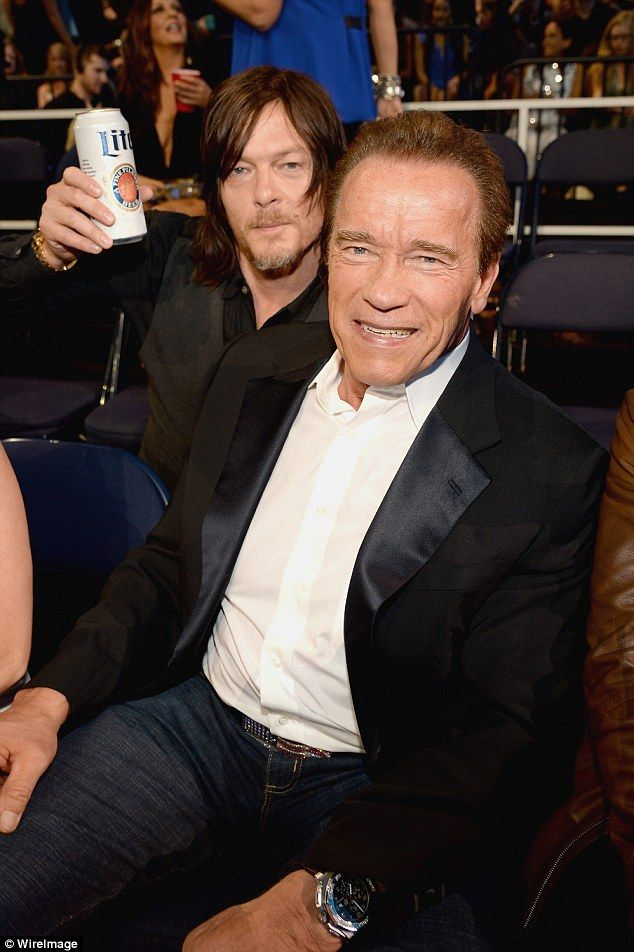 He's back: He then bonded with Terminator star Arnold Schwarzenegger, raising a tin of beer as he chatted to the star