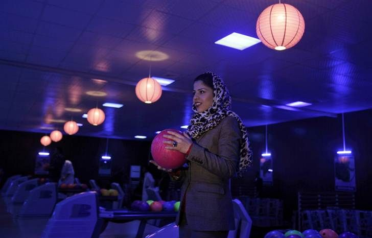 Meena Rahmani, 26, owner of The Strikers, Afghanistan's first bowling center, is pictured on Oct. 28. Located just down the street from Kabul's glitziest mall, Meena Rahmani opened Afghanistan's first bowling alley, offering a place where men, women and families can gather, relax and bowl a few games. (Muhammed Muheisen / AP)