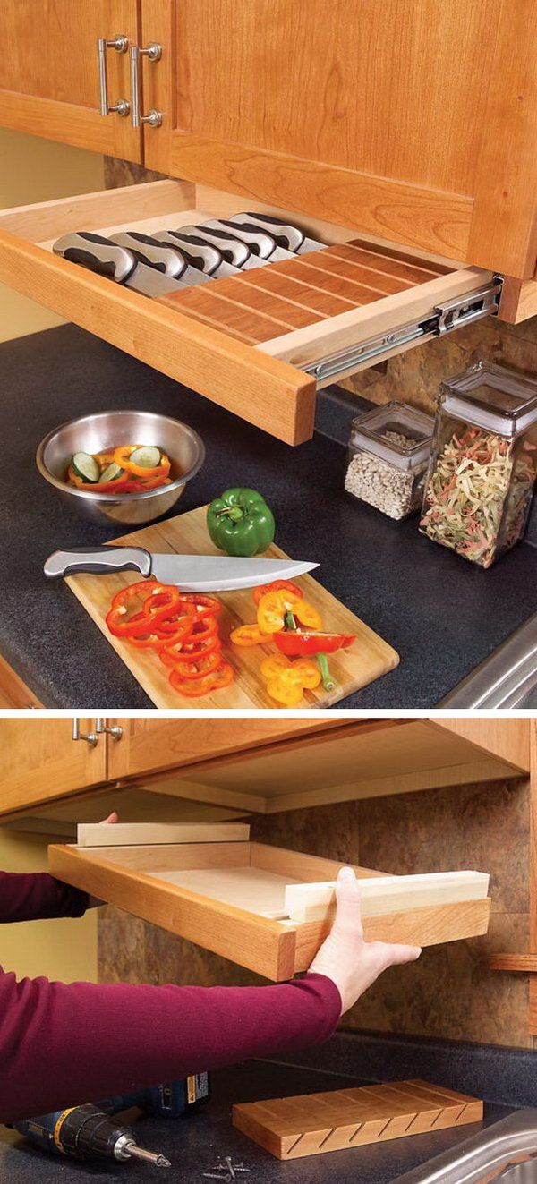 This pull out drawer under kitchen cabinet is perfect for storing knives. http://hative.com/clever-kitchen-storage-ideas/