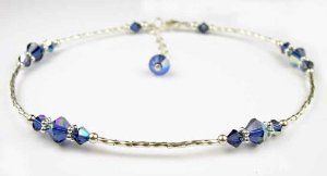 Damali .925 Sterling Silver Anklets Dark Sapphire - September Swarovski Crystal Ankle Bracelets - SMALL 8.5 In. Damali. $49.95. Genuine freshwater pearls. Adjustable 1 Inch chain extenstion included. .925 Sterling Silver. Genuine Swarovski Austrian Crystals. Secure lobster clasp closure