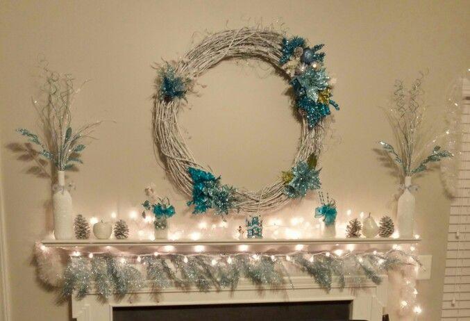 Wreath: twig wreath, white spray paint, silver giltter spray paint & embellishments & hot glue gun. Wine bottles: saved wine bottles, boiling  water & dawn to soak labels off, white spray paint, modpodge, epsom salt, iridescent glitter & clear coat spray paint  Mason jars: glass frosting spray paint & ribbon