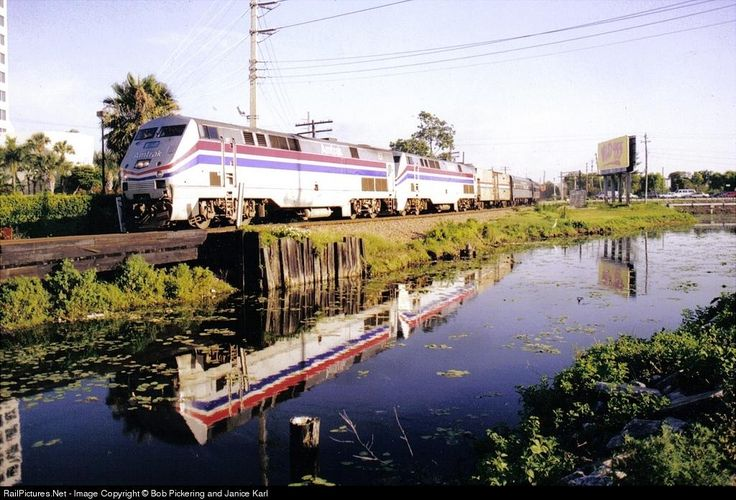 Northbound Silver Palm races past a canal in tropical West Palm Beach. Much has changed, the Palmetto no longer even runs into Florida and this scene has changed with the double tracking of the route for Tri Rail.
