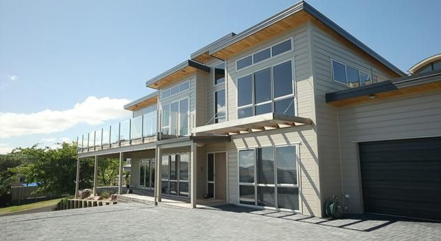 Jenny's home is two storeys to maximise a view across Lake Taupo, with separate guest accommodation on the lower level.