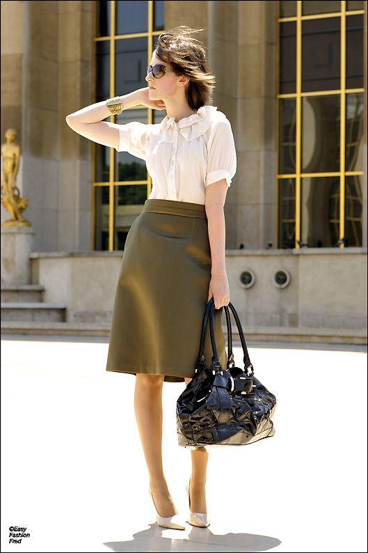 Fluffy blouse, an A-line skirt, and matching pumps.