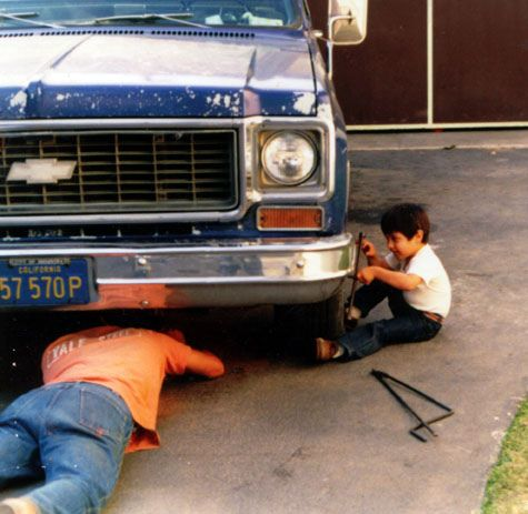 son and dad working on car