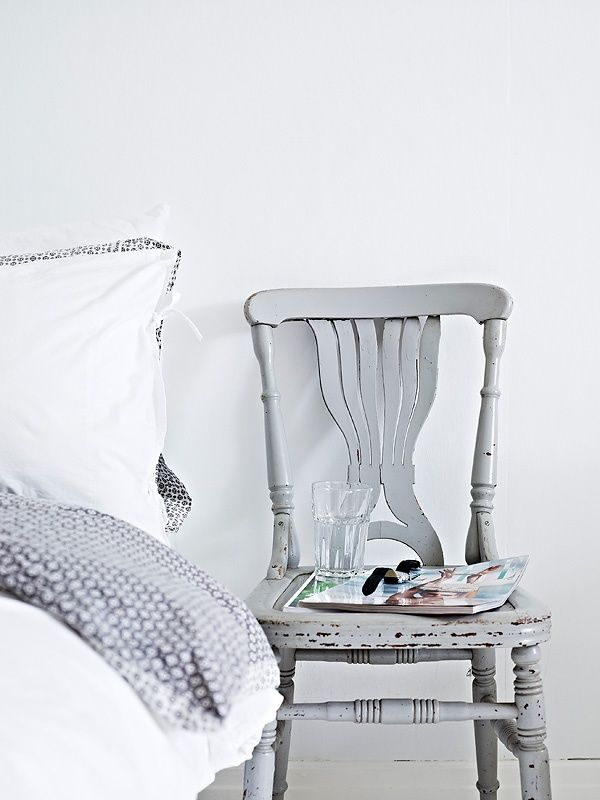 old chair as a bedside table and nice bedding