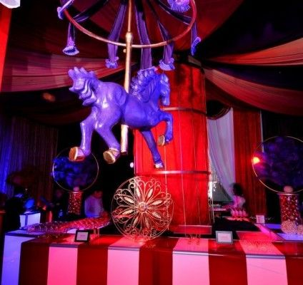 Big top decor! #merrygoround #circus #bigtop #eventdecor This is a great example of a #magnificent #foodstation #display. #events #brightideas #purple #horse #redandwhite #drape #tent #tabledecor