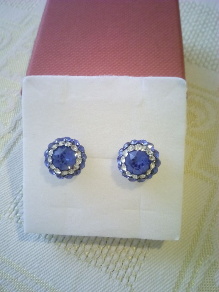 Silver stud earrings with Swarovski crystals in Ceralun construction.