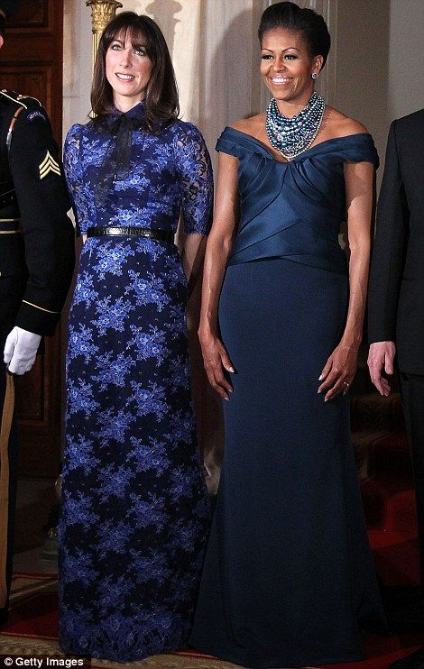 U.S. first lady Michelle Obama (R) and Samantha Cameron (L), wife of British Prime Minister David Cameron