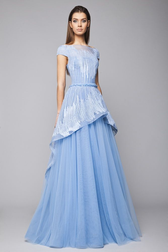 Light Blue princess Tulle gown with embroidered bodice and cutaway overskirt, cap sleeves and belt on the waistline.