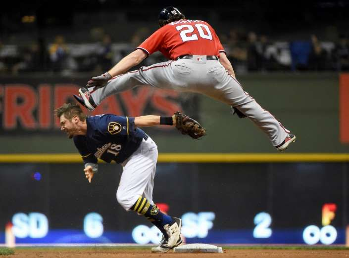 FLYING ATTEMPT:   The Nationals' Daniel Murphy attempts to avoid the tag by the Brewers' Eric Sogard but is called out on Sept. 2 in Milwaukee. The Nationals won 3-2.
